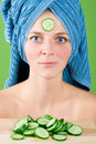 Woman in blue towel and mask from cucumber Stock Photos