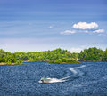 Woman boating on lake piloting motorboat in georgian bay ontario canada Royalty Free Stock Photos