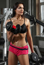 Woman bodybuilder training with dumbbell Stock Photo