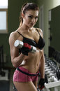 Woman bodybuilder training with dumbbell Stock Images