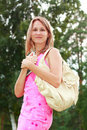 Woman with a book in hand and a handbag Royalty Free Stock Photo
