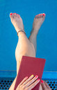 Woman with the book by the pool swimming Royalty Free Stock Photo