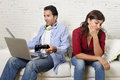 Woman bored and frustrated ignored while internet addict husband or boyfriend using digital tablet networking young attractive Stock Photography