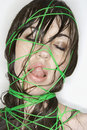 Woman bound with string. Royalty Free Stock Photo
