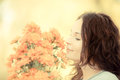 Woman with bouquet of autumn flowers smiling outdoors shallow depth field Stock Photo