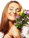 Woman with bouquet flowers portrait of happy smiling middle age Stock Images
