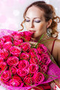 Woman with bouquet of pink roses Stock Photo