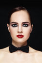 Woman with bow tie portrait of young beautiful glamorous Royalty Free Stock Image