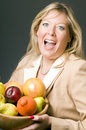 Woman with bowl of fruit Royalty Free Stock Photo