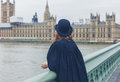 Woman with bowler hat at hopuses of parliament Royalty Free Stock Photo