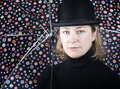 Woman in a bowler hat with umbrella Stock Images