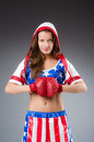 Woman boxer in uniform with us symbols Stock Image