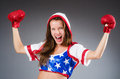 Woman boxer in uniform with us symbols Royalty Free Stock Photos