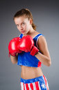 Woman boxer in uniform with us symbols Royalty Free Stock Image