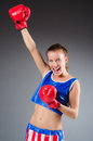 Woman boxer in uniform with us symbols Stock Photo