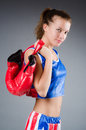 Woman boxer in uniform with us symbols Royalty Free Stock Photo