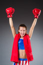 Woman boxer in uniform with us symbols Stock Photography