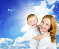 Woman and boy against blue sky Royalty Free Stock Images
