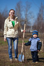 Woman with boy   planting  tree Royalty Free Stock Photo