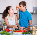 Woman and boyfriend preparing soup in kitchen smiling women with vegetables vegeterian domestic Royalty Free Stock Photos