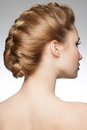 Woman with braid hairdo portrait of young beautiful blond hair and rear view hairstyle tress Stock Photography