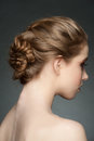 Woman with braid hairdo studio portrait of young beautiful blond hair and rear view Royalty Free Stock Photography