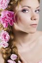 Woman with with braids and roses in hair Stock Photo