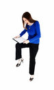 Woman breaking her clip board a young in black dress pants and a blue sweater is very angry try to break isolated for white Stock Photo