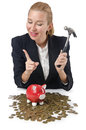 Woman breaking piggy bank Stock Image