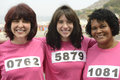 Woman on breast cancer awareness race diverse women Stock Photos