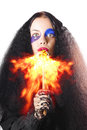 Woman breathing fire from mouth scary with long black hair or blowing white background Royalty Free Stock Images