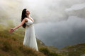 Woman breathing fresh mountain air Royalty Free Stock Photo