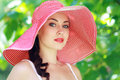 Woman in bright summer hat beautifull young brunette on the meadow on a warm day Royalty Free Stock Images