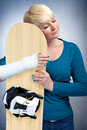 Woman with broken arm hugging her snowboard i love snowboarding Stock Photo