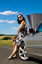 Woman by broken down car Royalty Free Stock Images