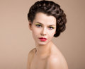Woman with brown hair romance femininity nostalgia retro styled pinup girl braided Royalty Free Stock Photo