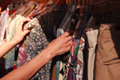 Woman browsing clothes at market Royalty Free Stock Photo