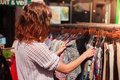 Woman browsing clothes at market Royalty Free Stock Photo