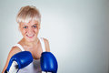 Woman with bruise angry boxing at gray background Stock Image
