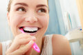 Woman brushing cleaning teeth oral hygiene young girl with toothbrush in bathroom Royalty Free Stock Photography