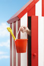 Woman with bucket and spade in beach cabin s hand holding Royalty Free Stock Photo