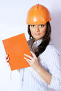 Woman builder the in the construction helmet with a notebook in hand Royalty Free Stock Image