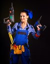 Woman builder with construction tools happy Stock Image
