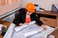 Woman builder engineer in helmet