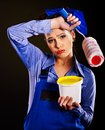 Woman builder with paint cans tired Stock Images