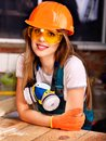 Woman in builder respirator. Royalty Free Stock Photo