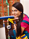 Woman builder with special tool fixing heating system Stock Photo