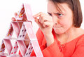 Woman building card tower Stock Image