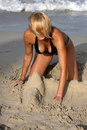Woman building a sandcastle  Royalty Free Stock Images