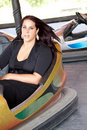 Woman in bumper car Royalty Free Stock Photo